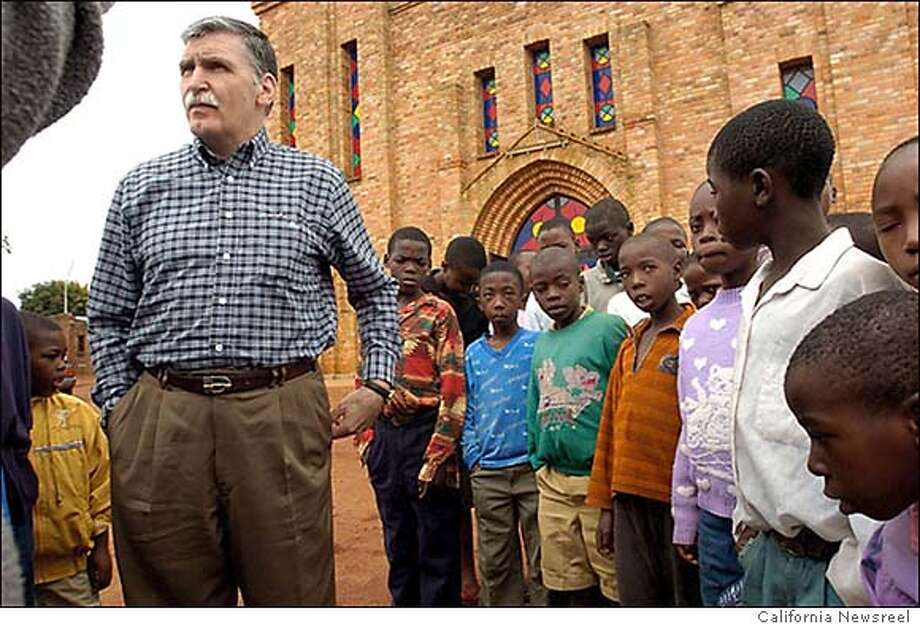 SHAKE10 Romeo Dallaire with school children in Shake Hands with the Devil. CR: California Newsreel