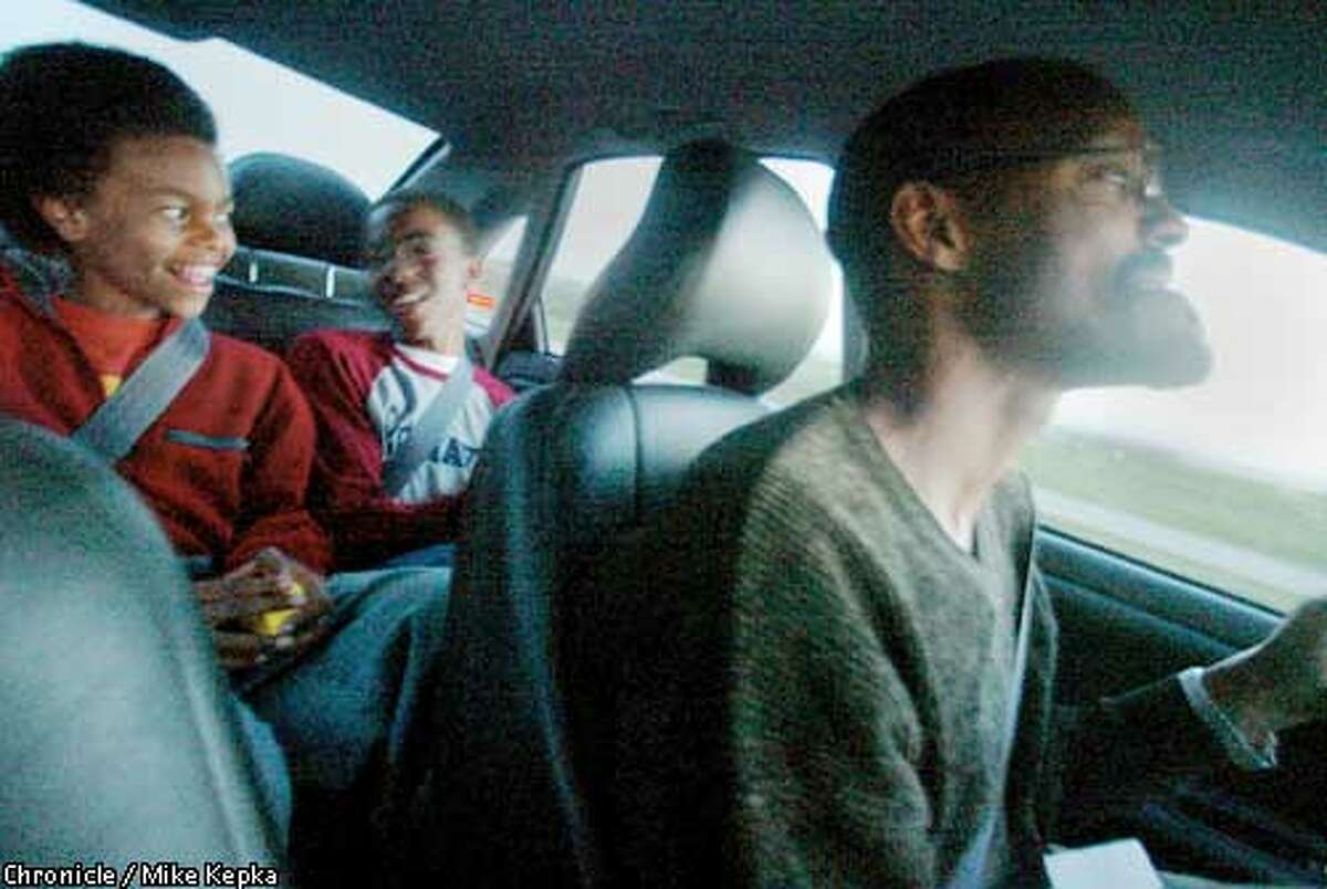 The family man - Oakland school board president Greg Hodge drives his sons Kumi, 11, and Chukwudi, 13, home from an afterschool activity. BY MIKE KEPKA/THE CHRONICLE