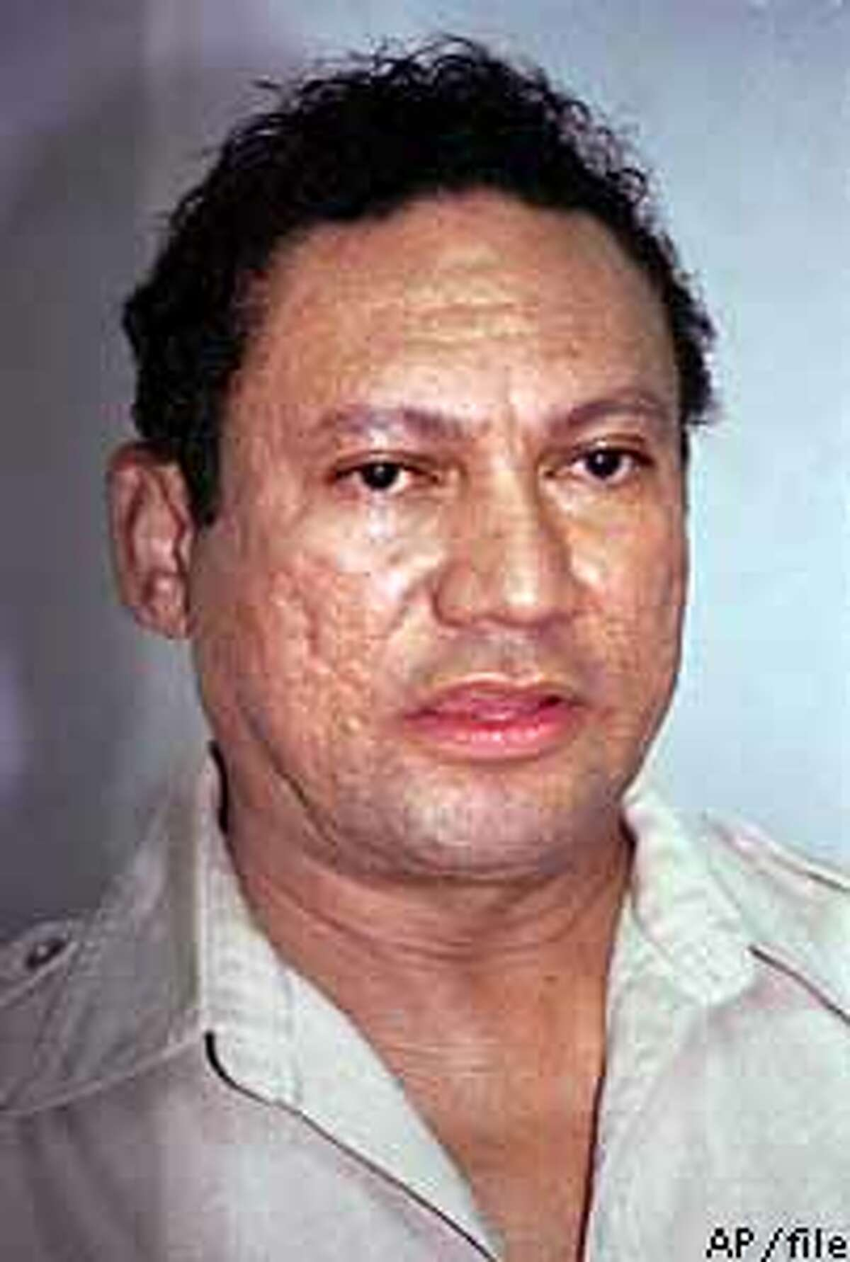 FILE -- Deposed Panamanian leader Manuel Noriega is shown in this undated photo. A former member of the Cali cocaine cartel testified in Miami Monday, March 4, 1996, that he paid a Panamanian smuggler $1.25 milion to testify against Noriega, convicted on drug charges in 1992. Noriega's attorneys are seeking a new trial, charging that prosecutors were aware of the secret deal but kept it secret from the judge, the defense and the jury. (AP Photo/file)