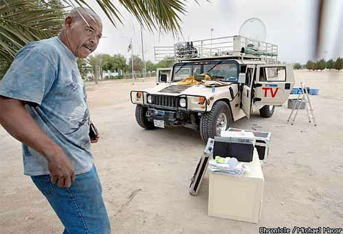 Quincy Brown, of El Dorado Hills, Ca. (north of sacramento) works on a Hummer vehicle, outfitted for live transmissions from a possible battlefield. The Hummer belongs to ABC, the equipment aboard for coverage is somewhere around $500,000.ABC has two of therse vehicles. Downtown Kuwait City as the News Media prepares to be embedding into military units, major networks scramble to complete work on special vehicles. by Michael Macor/The Chronicle