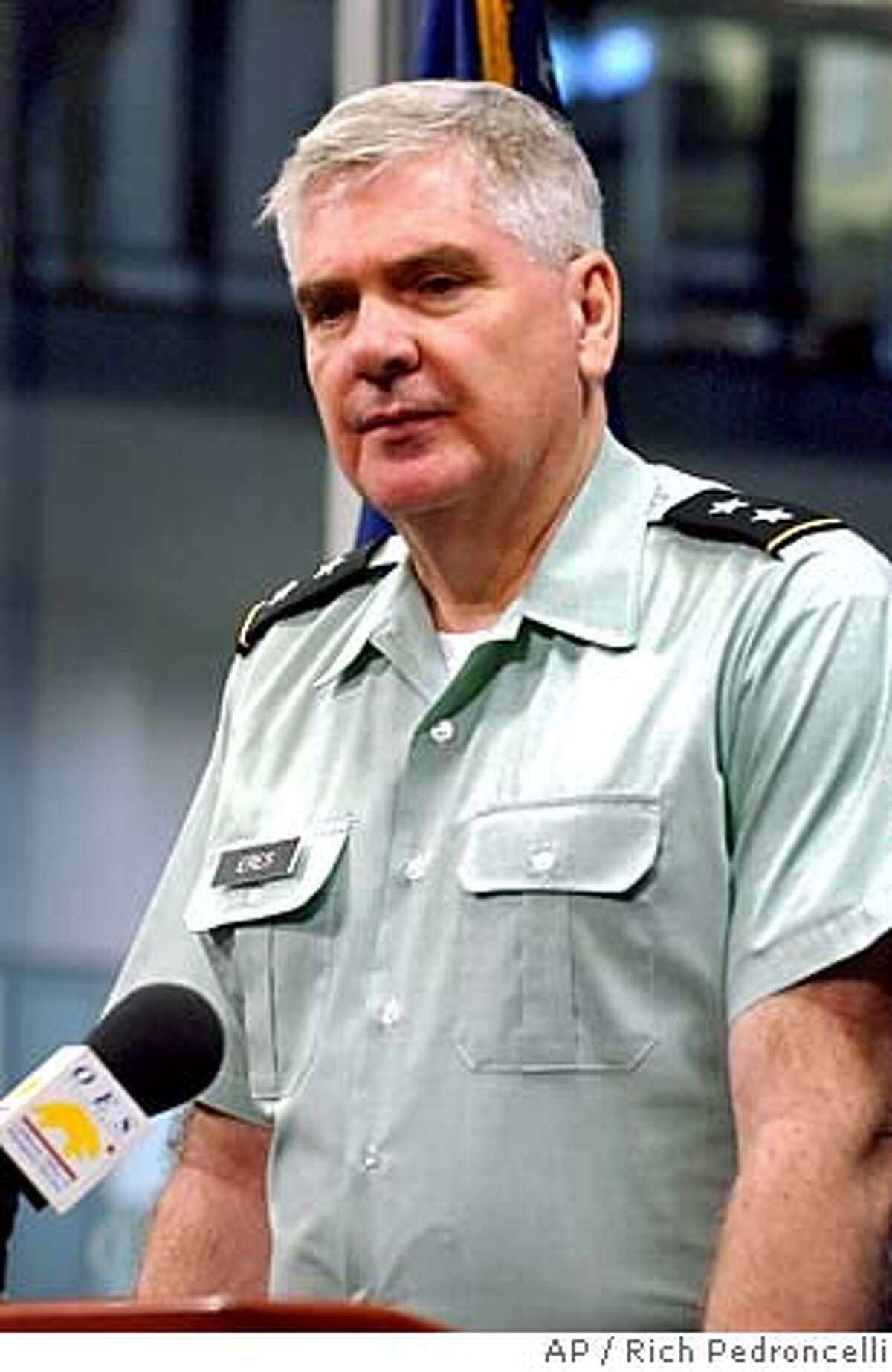 **FILE** Maj. Gen. Thomas Eres, commanding officer of the California National Guard, is shown at the California Office of Emergency Services Command Center, in Rancho Cordova, Calif. in this Aug. 6, 2004 file photo. Eres resigned his position late Monday amid allegations that he failed to meet Pentagon combat requirements and may have improperly offered military services to a political group. Eres, 61, seen in this was appointed to the position by Gov. Arnold Schwarzenegger in March of 2004.(AP Photo/Rich Pedroncelli, file) AUGUST 6 2004 FILE PHOTO