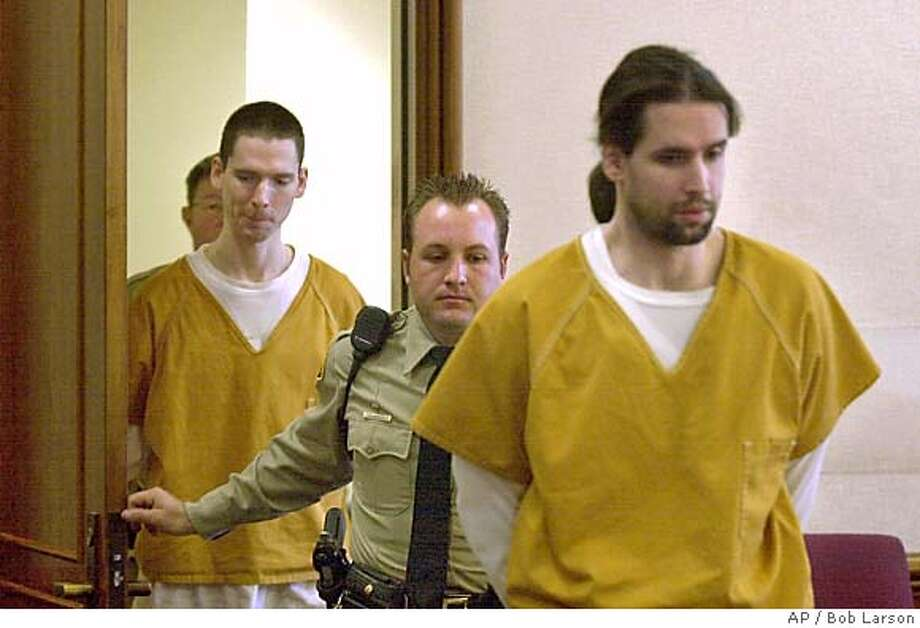 Brothers Justin Helzer, 29, left, and Glenn Helzer, 31, are led into court for a preliminary hearing in Martinez, Cailf., Monday Dec. 3, 2001. The Helzers and their housemate Dawn Godman, 27, are accused of going on a killing spree that left five people dead including Selina Bishop, the daughter of blues guitarist Elvin Bishop. (AP Photo/Contra Costa Times, Bob Larson ) Ran on: 06-10-2004  Carma Helzer leaves the Martinez Courthouse after her sons' arraignment. Ran on: 06-24-2004  Justin Helzer Ran on: 11-09-2004  Glenn Helzer entered a surprise guilty plea earlier this year just before he was to be tried. PLEASE CREDIT THE CONTRA COSTA TIMES MAGS OUT Photo: BOB LARSON