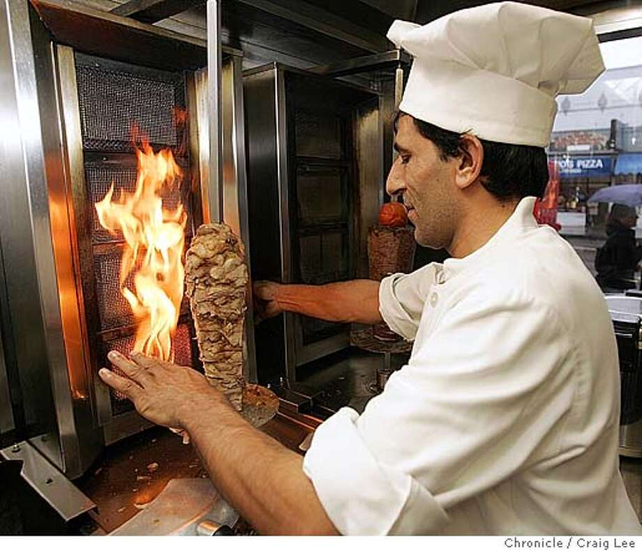 Alaturka restaurant at 869 Geary street near Larkin. They serve Turkish cuisine. Photo of chef, Naim Sit, roasting chicken doner.  Event on 12/9/04 in San Francisco. Craig Lee / The Chronicle Photo: Craig Lee