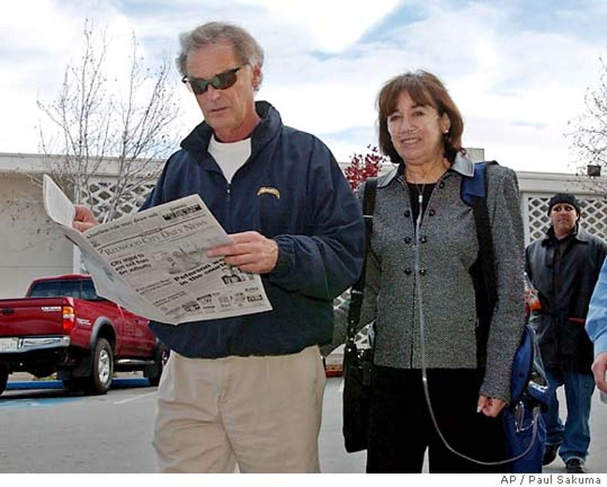 Lee and Jackie Peterson, parents of Scott Peterson, arrive at a Redwood City, Calif., courthouse, after a lunch break, Thursday, Dec. 9, 2004 during final arguments of the penalty phase of the Peterson trial. Peterson is the Modesto, Calif., man who was convicted of the murder of his wife, . (AP Photo/Paul Sakuma)