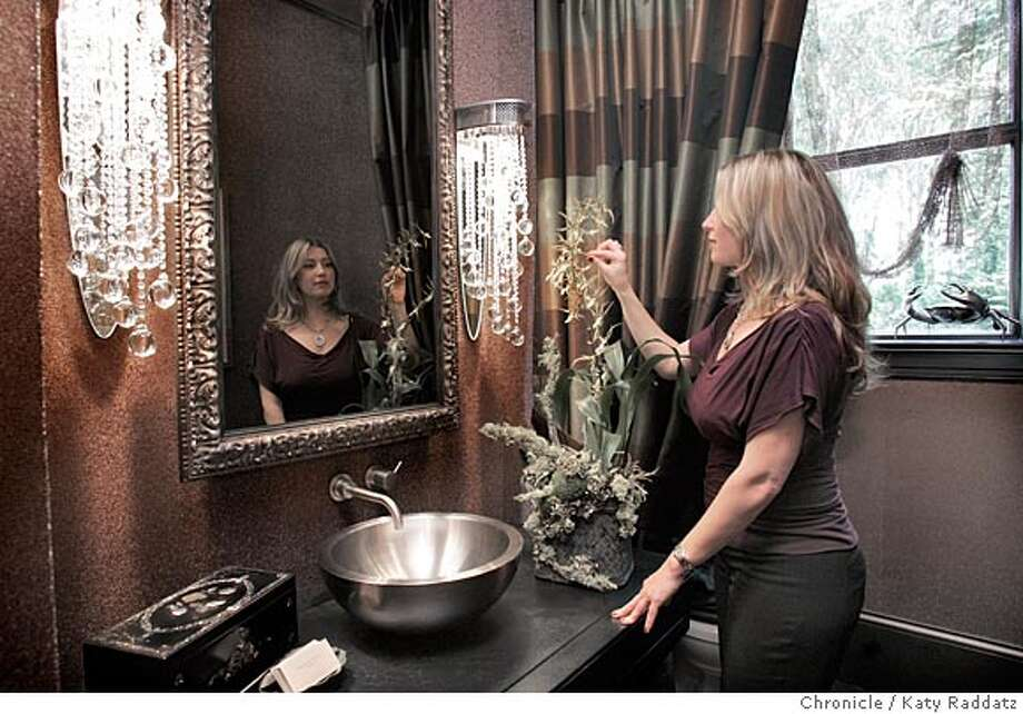 Follow on the San Francisco Showcase house that shows readers ideas for the bathroom. This house, at #1 Cherry St. in San Francisco, has 5 and a half baths. SHOWN: The first floor powder room designed by Ashley Roi Jenkins (she's in the picture), featuring glass beaded wallpaper and crystal light sconces. Photo taken on 5/9/05, in SAN FRANCISCO, CA.  By Katy Raddatz / The San Francisco Chronicle Photo: Katy Raddatz