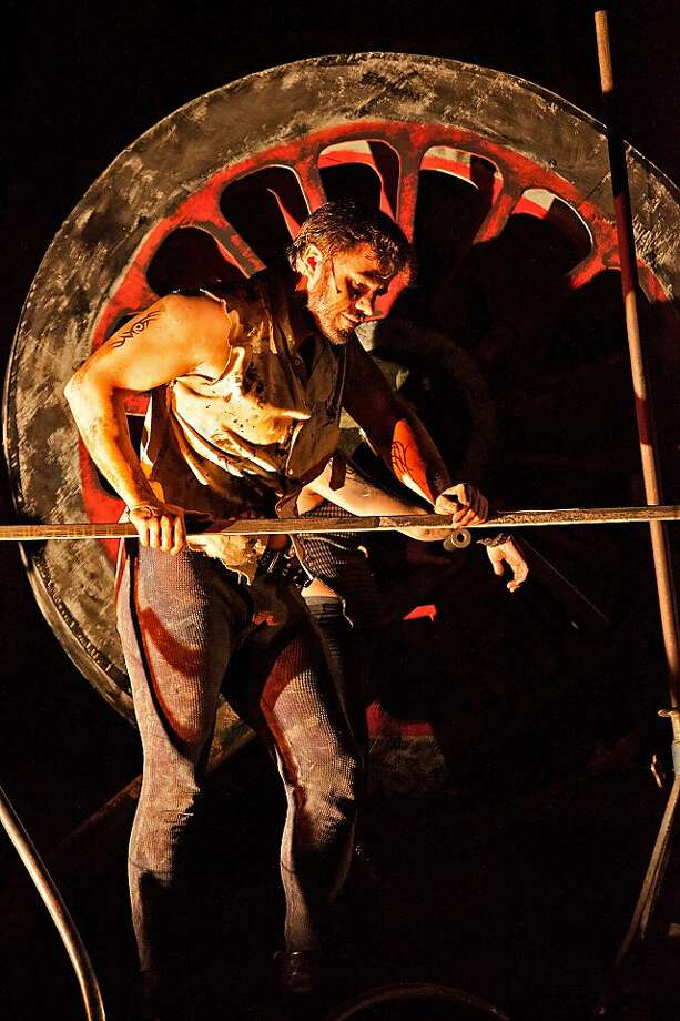 """Eugene Brancoveanu in """"Machine,"""" a """"fire opera"""" by writer-director Mark Streshinsky and composer Clark Suprynowicz at The Crucible in Oakland Photo: Gary J. Wilson"""