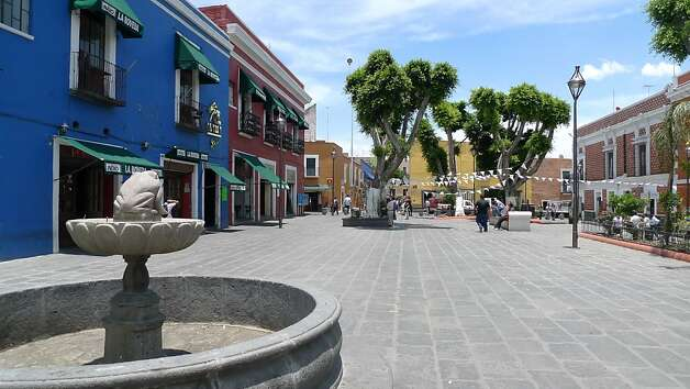 The Plazuela de los Sapos in Puebla, Mexico, is lined with antique shops and bars and restaurants. Photo: Jill K. Robinson
