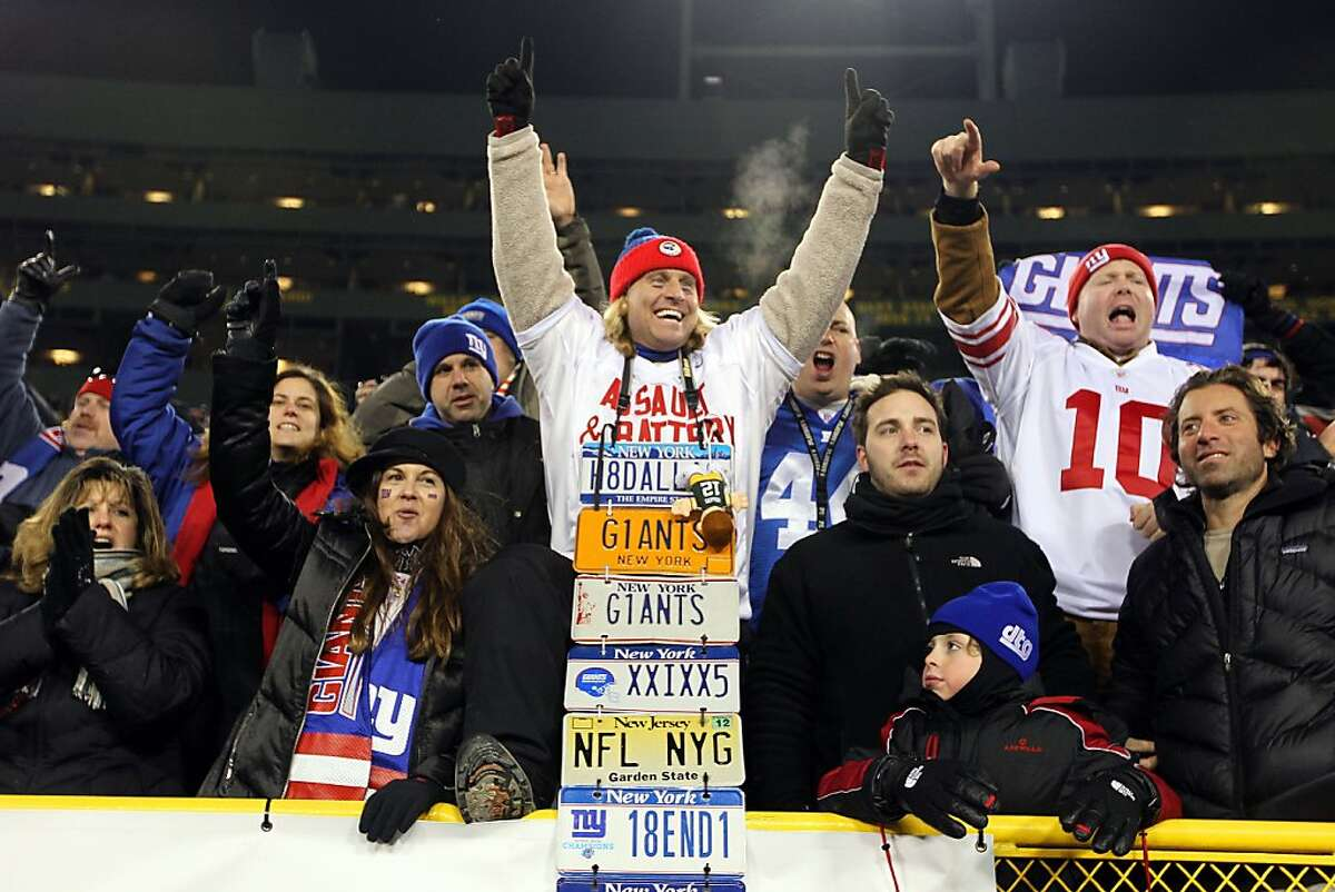GREEN BAY, WI - JANUARY 15: Fans of the New York Giants celebrate after their team defeated the Green Bay Packers during their NFC Divisional playoff game at Lambeau Field on January 15, 2012 in Green Bay, Wisconsin. (Photo by Jamie Squire/Getty Images)