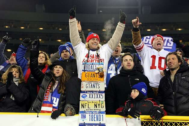 GREEN BAY, WI - JANUARY 15:  Fans of the New York Giants celebrate after their team defeated the Green Bay Packers during their NFC Divisional playoff game at Lambeau Field on January 15, 2012 in Green Bay, Wisconsin.  (Photo by Jamie Squire/Getty Images) Photo: Jamie Squire, Getty Images