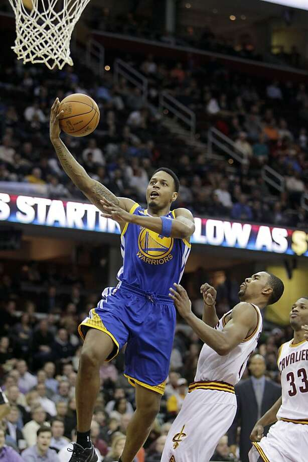 Golden State Warriors' Brandon Rush shoots on Cleveland Cavaliers' Ramon Sessions in an NBA basketball game Tuesday, Jan. 17, 2012, in Cleveland. (AP Photo/Mark Duncan) Photo: Mark Duncan, Associated Press