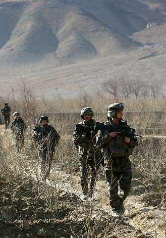 (FILES) A picture taken on January 7, 2010 shows French soldiers taking part in a patrol near Tagab in Kapisa Province.  Four French soldiers were shot dead and 16 were wounded by a member of the Afghan army in eastern Afghanistan on January 20, 2012, a NATO spokesman and Afghan officials said. AFP PHOTO / JOEL SAGET (Photo credit should read JOEL SAGET/AFP/Getty Images) Photo: Joel Saget, AFP/Getty Images