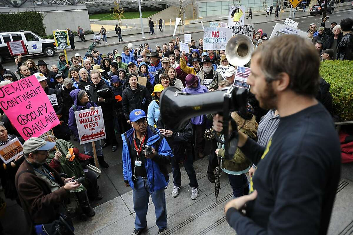 Jed Holtzman of Move to Amend gives the crowd details on other Occupy actions happening around the city. In conjunction with Occupy West, Protestors gather in front of the 9th Circuit Court of Appeals in San Francisco to demand a change to the