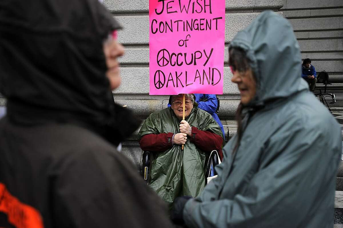 Abigail Grafton of Berkeley braved the rain to show her support to the Occupy movement. In conjunction with Occupy West, Protestors gather in front of the 9th Circuit Court of Appeals in San Francisco to demand a change to the