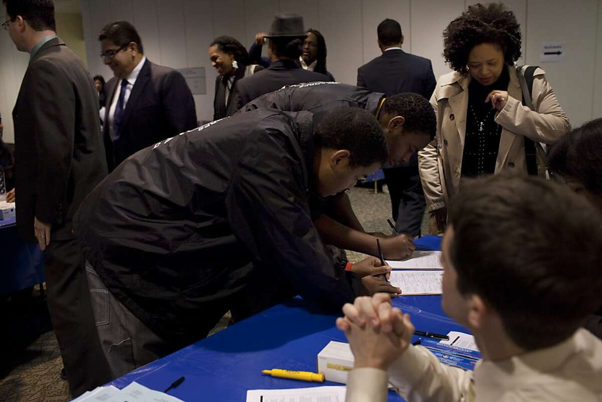 Attendees register in the Elihu Harris State Office Building where state and local officials will meet to discuss how to improve life chances for young men of color on Friday, January 20, 2011 in Oakland, Calif.