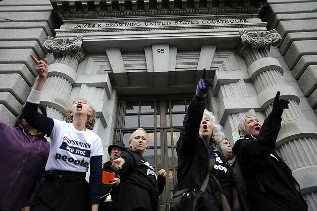"A small flash mob dances on the steps of the court house.  In conjunction with Occupy West, Protestors gather in front of the 9th Circuit Court of Appeals in San Francisco to demand a change to the ""Citizens United"" Supreme Court ruling.  Friday January 20th, 2011. Photo: Michael Short, SPECIAL TO THE CHRONICLE"