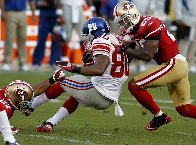 Cornerback Chris Culliver (29) makes quick work of Victor Cruz after a reception in the second half. The San Francisco 49ers defeated the New York Giants 27-20 Sunday November 13, 2011 at Candlestick Park. Photo: Brant Ward, The Chronicle