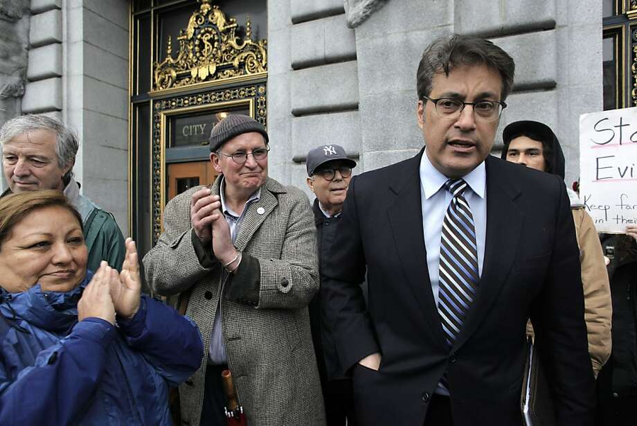 San Francisco Sheriff Ross Mirkarimi shows his support for the Occupy Bernal group gathered to protest a foreclosure auction on the steps of City Hall, during a national day of action against corporations and financial institutions in San Francisco, Calif. on Friday, Jan. 20, 2012.  They were successful in getting the auction postponed. Photo: Michael Macor, The Chronicle