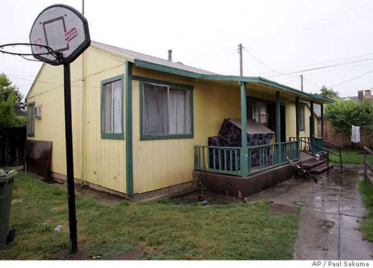 This photo shows the house in Lodi, Calif., Wednesday, June 8, 2005, where Federal authorities say Hamid Hayat and his father, Umer Hayat, 47, lived. Both were arrested after the younger Hayat allegedly acknowledged that he attended an al-Qaida camp in Pakistan in 2003 and 2004, according to an affidavit by FBI Special Agent Pedro Aguilar that was unsealed Tuesday. (AP Photo/Paul Sakuma)