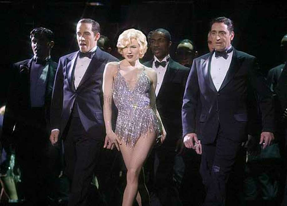 """Renee Zellweger, star of the film """"Chicago"""" is shown in this scene from the film which received an Academy Award nomination as best motion picture as nominations for the 75th annual were announced by the Academy of Motion Pictures Arts and Sciences in Beverly Hills, February 11, 2003. """"Chicago"""" received 13 nominations, the most for any film. The will be presented in Hollywood March 23, 2002. REUTERS/Miramax Films/Handout Photo: HO"""