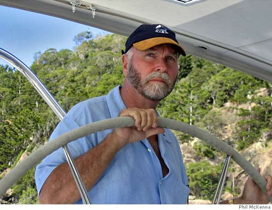 SORCERER06.jpg  Geneticist J. Craig Venter at the helm of the Sorcerer II in the Whitsunday Islands (Hook Island is in the background)  Credit Phil McKenna.  (831-656-9104 should you need to reach him) Photo: Phil McKenna