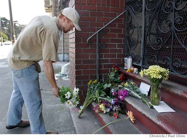 Paul Wallace leaves a bouquet of flowers at the growing memorial shrine at the Faibish home. Neighbors gathered in front of 711 Lincoln Way on 6/4/05 in San Francisco, Calif. to talk about Friday's tragic dog mauling death of 12-year-old Nicholas Faibish by his family's two pet pit bulls Ella and Rex.  PAUL CHINN/The Chronicle Photo: PAUL CHINN