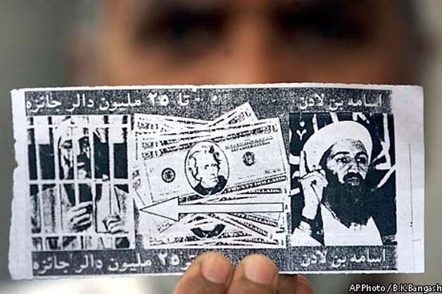 An US-reward leaflet is seen Friday, March 7, 2003 in Islamabad, Pakistan, offering US$25 million reward for providing information about Saudi dissident Osma bin Laden, wanted by United States government on terrorism charges. Leaflets seek help from residents in finding the al-Qaida chief, were dropped by US planes over stretches of eastern Afghanistan and Pakistan.(AP Photo / B.K.Bangash) Photo: B.K.BANGASH