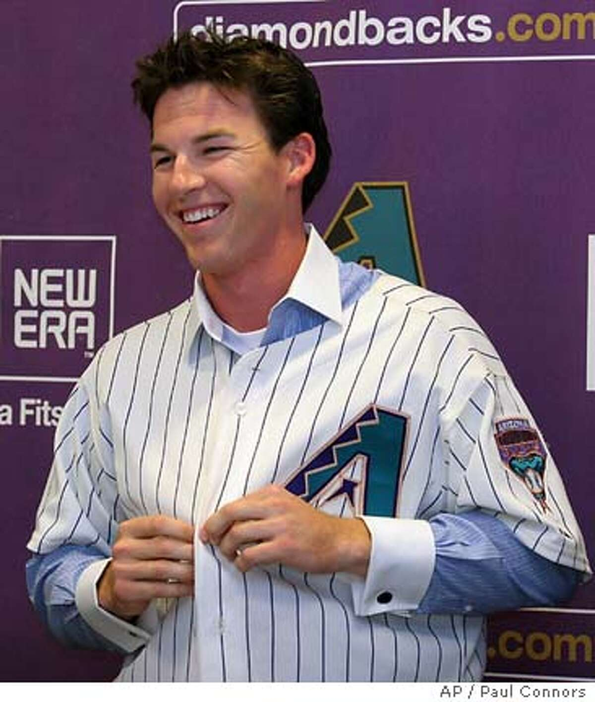 Diamondbacks infielder Stephen Drew dons a team jersey during a news conference announcing he had reached an agreement with the team Thursday, June 2, 2005, at Bank One Ballpark in Phoenix. Drew was the Diamondbacks' number one draft choice and brothe rof J.D. Drew.(AP Photo/Paul Connors)