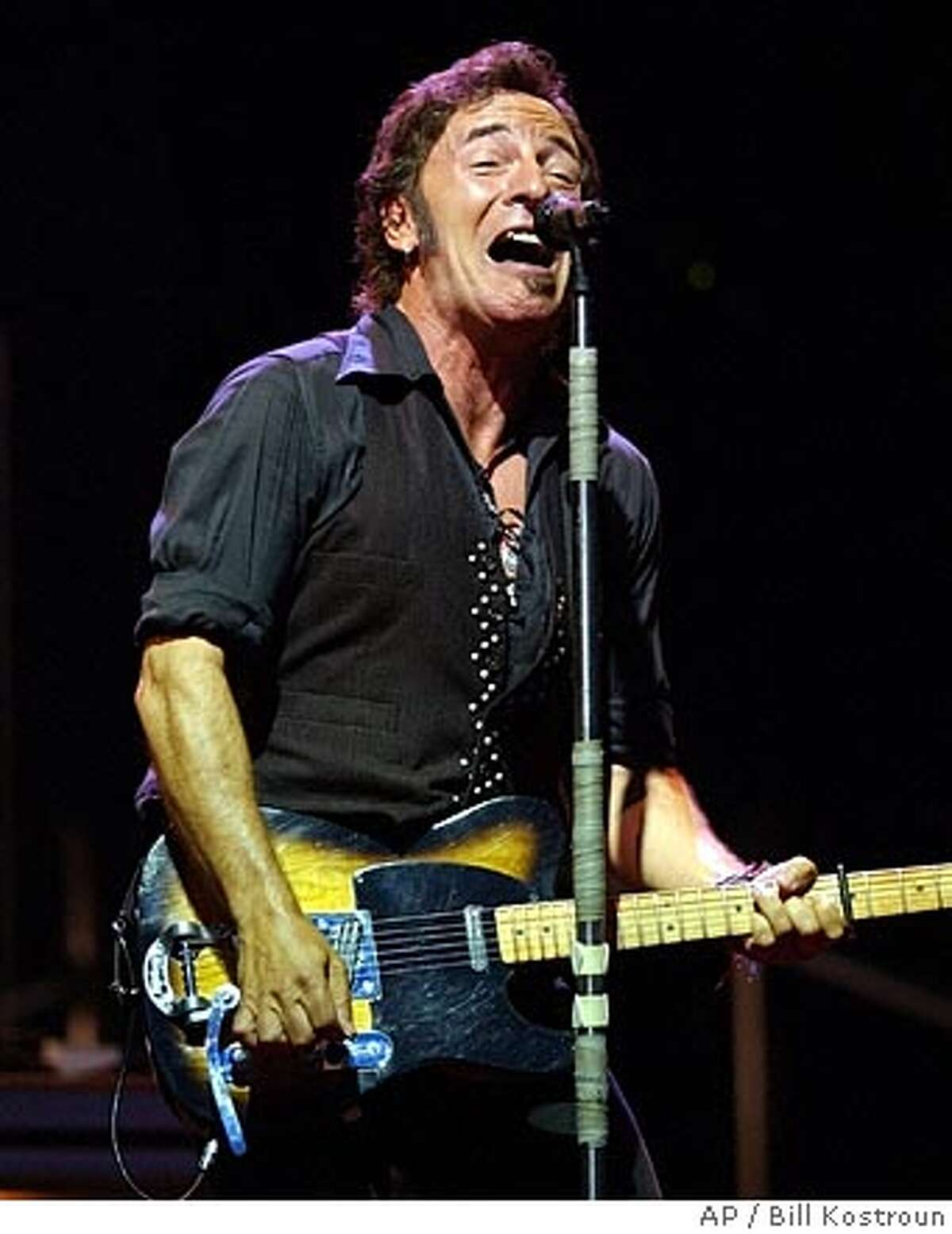 **FILE**Bruce Springsteen sings during the first of 10 sold-out shows on July 15, 2003, at Giants Stadium in East Rutherford, N.J. The New Jersey Sports and Exposition Authority's profits grew by about $14 million this year, thanks in large part to Bruce Springsteen. The authority's president, said Wednesday Dec.17, 2003, that its profit had grown from $34.4 million in 2003 to $48 million this year. He said the boost was mostly due to 10 sold-out shows that Springsteen and the E Street Band played a Giants Stadium in July and August. The profit is expected to drop to about $37.9 million next year-- unless Springsteen unexpectedly returns to Giants Stadium.(AP Photo/Bill Kostroun) Bruce Springsteen, shown at Giants Stadium in July, made $115.9 million. Ran on: 06-25-2004 The Boss says he wont play. A JULY 15 2003 FILE PHOTO