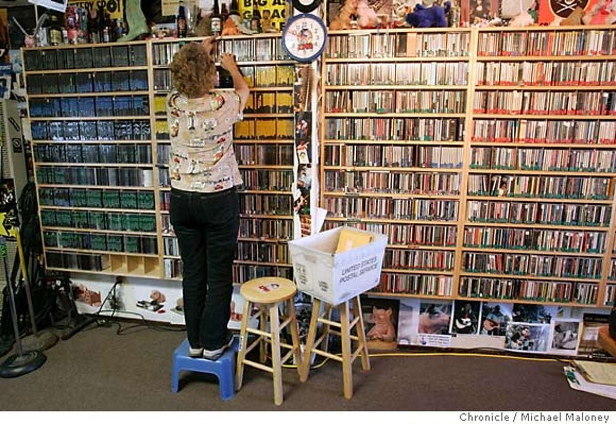 KPIG program director Laura Ellen Hopper, also the 10 am to 2 pm deejay, was program director at KFAT 25 years ago. She looks through a library of cds to find a listener's request. A small-town radio station that is one of the last in the state to offer live deejays 24/7 -- and allows them to play the songs they choose -- is moving to SF. KPIG radio in Watsonville, CA, will begin beaming its show to SF, the East Bay and Marin county beginning July 1. The direct descendant of infamous rebel radio station KFAT, which broadcast from Gilroy in the late 70s and early 80s, KPIG plays a similar mix of Americana, folk, blues, country, rock, and fake commercials. Photo by Michael Maloney / San Francisco Chronicle
