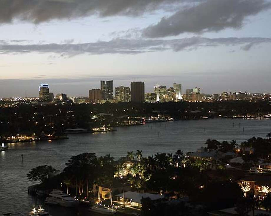After sunset: Fort Lauderdale, its skyline rising above the intracoastal waterway, promotes itself as a gay-friendly destination. Associated Press photo by Robert E. Klein