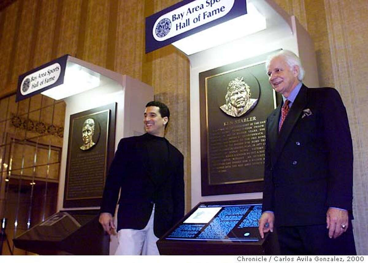BASHOFA-C-02MAR00-SP-CG --- Former Raiders quarterback, Ken Stabler, right, poses with Steve Medeiros, left, in front of Stabler's Bay Area Sports Hall of Fame placque at induction ceremonies in San Francisco, Ca., on Thursday, March 2, 2000. Stabler, Dave Stewart, Billy Wilson, and Pablo Morales are this years inductees. (CARLOS AVILA GONZALEZ/SAN FRANCISCO CHRONICLE) CAT