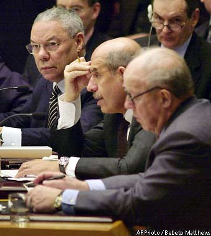 U.S. Secretary of State Colin Powell, left, and chief U.N. weapons inspector Hans Blix, right, listen as chief atomic energy inspector Mohamed ElBaradei delivers a report on Iraq during a meeting of the United Nations Security Council, Friday, March 7, 2003. (AP Photo/Bebeto Matthews) Photo: BEBETO MATTHEWS
