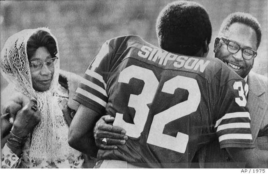 O.J. Simpson is hugged by his father James prior to the 49ers game with Tampa Bay.