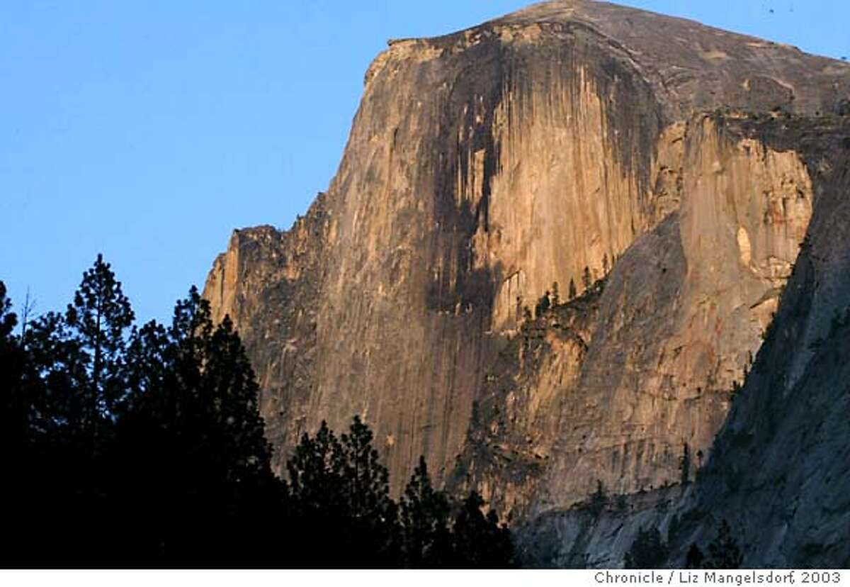 yosemite040_LM.jpg Event on 7/20/03 in Yosemite Valley. Half dome in yosemite valley at sunset. Story on a proposal to build new parking lot and campground in Yosemite Valley. LIZ MANGELSDORF / The Chronicle Half Dome helps draw 3 million visitors to Yosemite each summer. Many of them feed the bears. ProductNameChronicle MANDATORY CREDIT FOR PHOTOG AND SF CHRONICLE/ -MAGS OUT