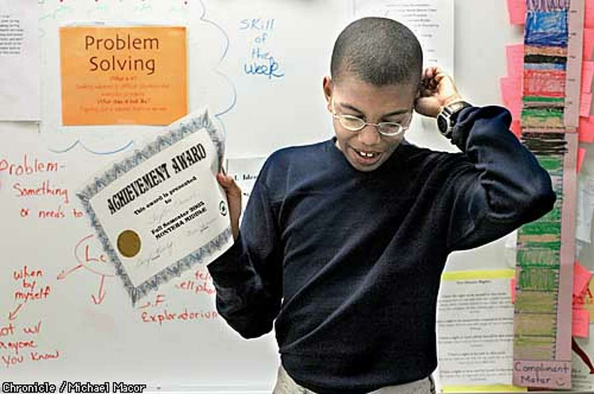 """Taylor Vassel an """"Inclusion Program"""" student accepts an achievement award while giving an acceptance speech, for """"Most Improved bBhavior"""", during a social skills class. Vassell has Asperger's Syndrome, a form of autism. Students who are part of of the """"Inclusion Program"""" at Montara Middle School, that helps exceptional children become part of a traditional classroom.A look at the funding of Special Education classes in Oakland Schools. by Michael Macor/The Chornicle"""