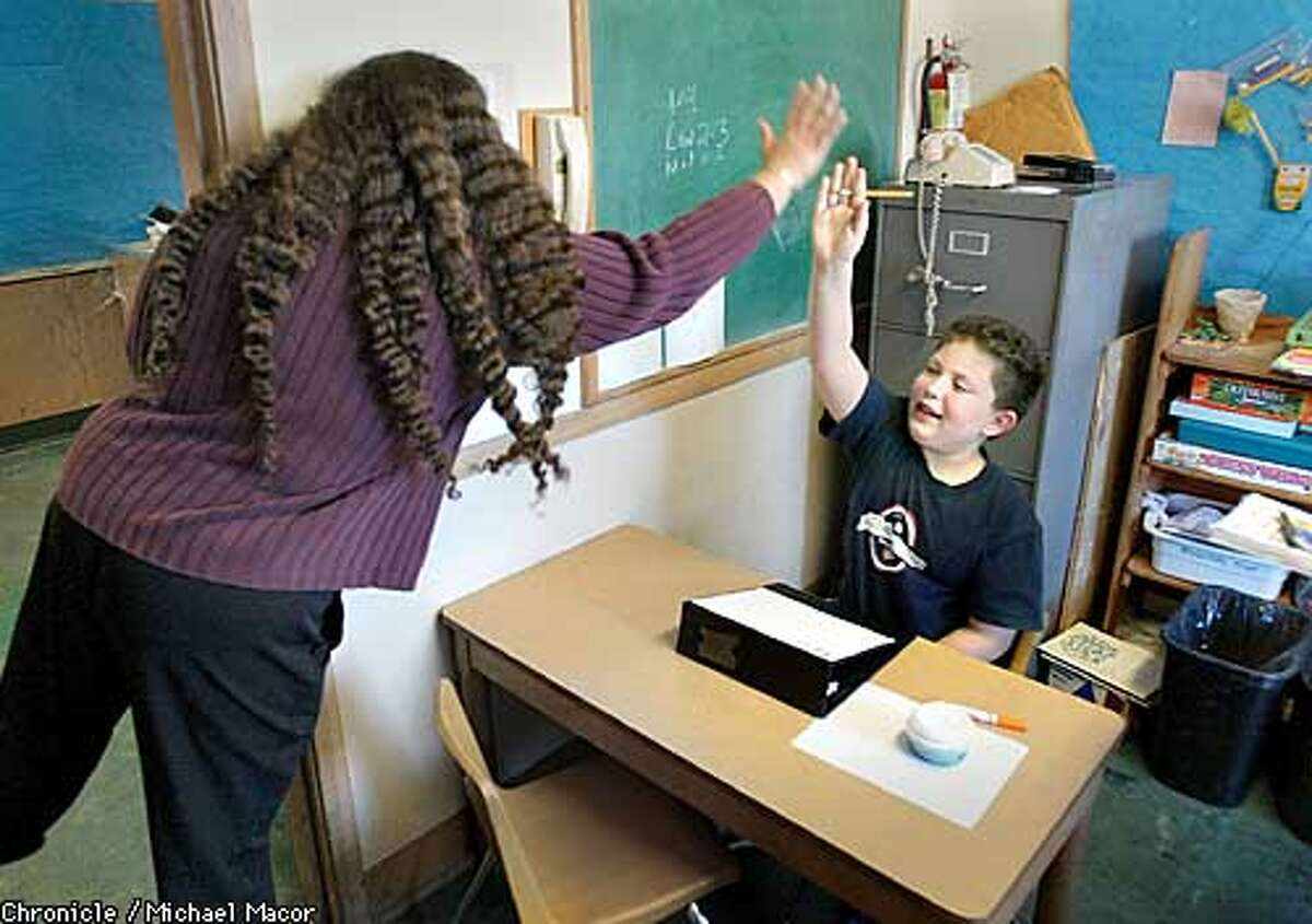 Evan gets a high- five from his aide Jolie Harris following the completion of a task in a Occupational Therapy class at Hillside Elementary. Evan Marymee,8 has Asperger's Syndrome, a form of autism in which he has trouble socializing with peers, and doesn't understand that others have feelings different from his own. Exploring the broken funding system behind special education in Oakland Schools. by Michael Macor/The Chronicle