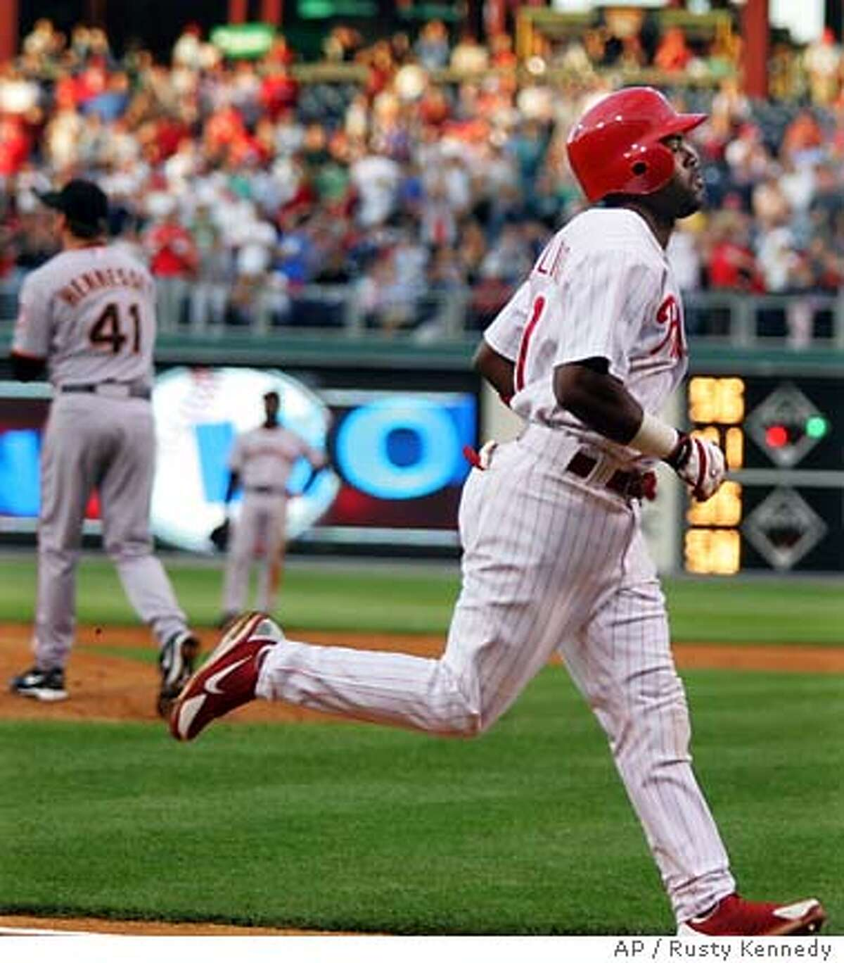 Philadelphia Phillies Jimmy Rollins rounds the bases after a 2-run home run off San Francisco Giants Brad Hennessey in the second inning Thursday,June 2, 2005 in Philadelphia. (AP Photo/Rusty Kennedy)