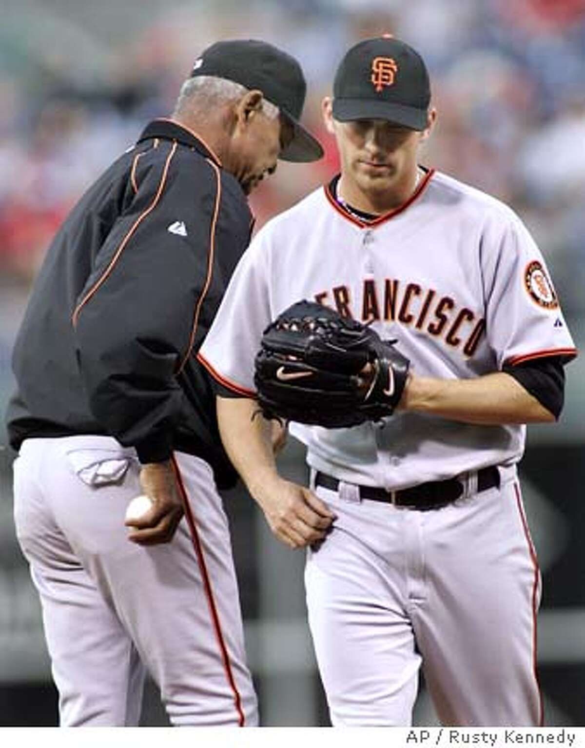 San Francisco Giants pitcher Brad Hennessey walks off the mound after being lifted by manager Felipe Alou in the third inning against the Philadelphia Phillies Thursday,June 2, 2005 in Philadelphia. (AP Photo/Rusty Kennedy)