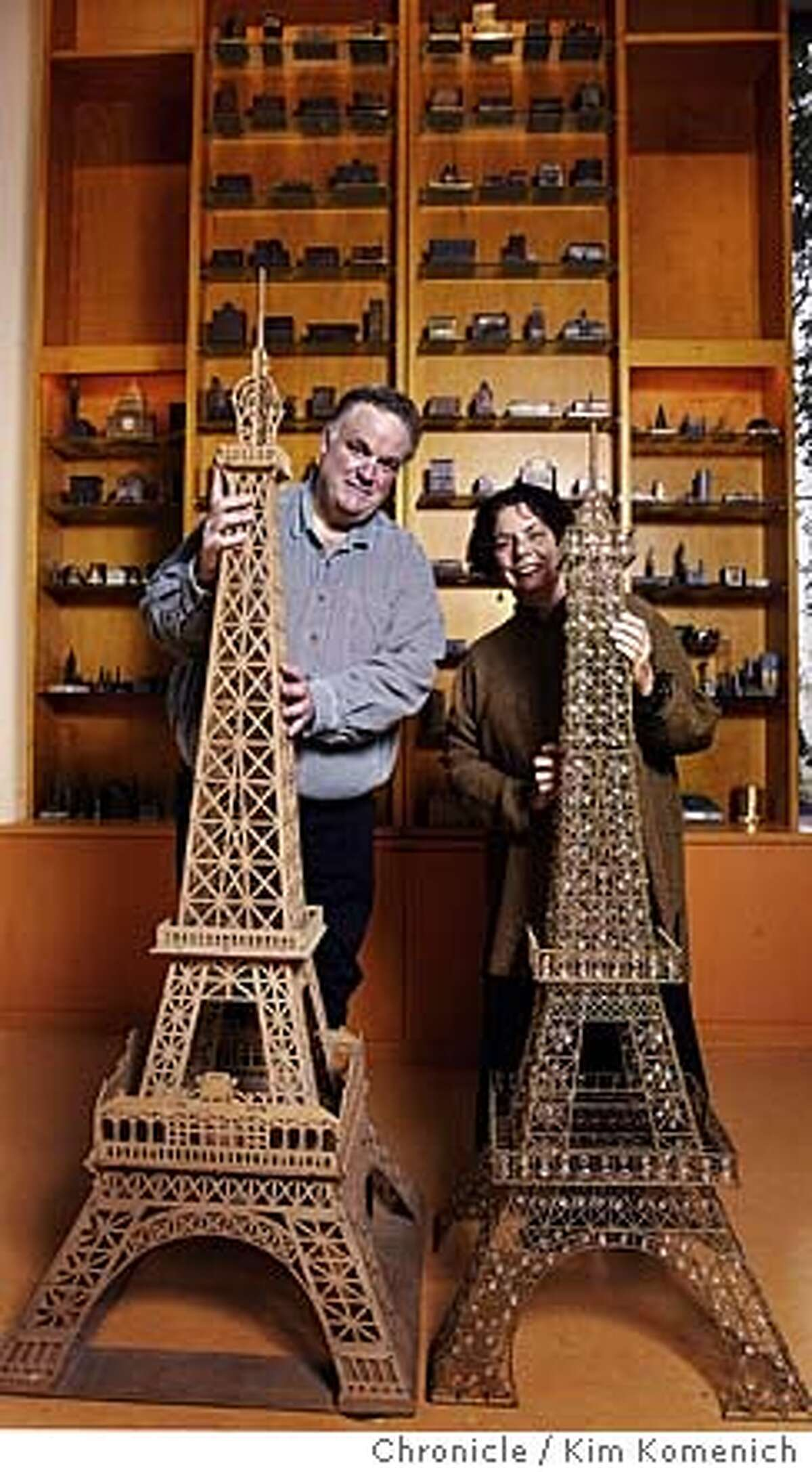 For the past 18 years David Weingarten (L) and Margaret Majua (R) of Lafayette collect miniature renditions of recognizable buildings from around the world. They have dedicated a room in their home to their collection including these whopping Eiffel towers. Photo by Kim Komenich in Lafayette.