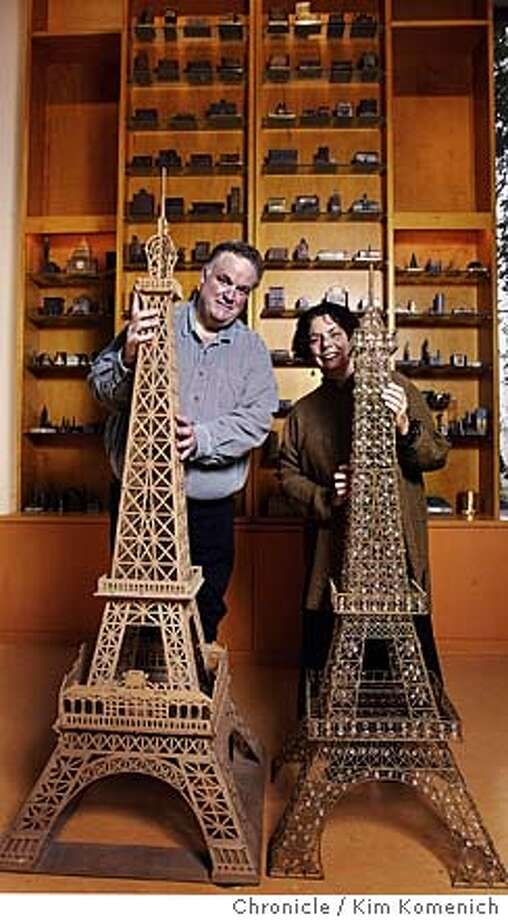 For the past 18 years David Weingarten (L) and Margaret Majua (R) of Lafayette collect miniature renditions of recognizable buildings from around the world. They have dedicated a room in their home to their collection including these whopping Eiffel towers. Photo by Kim Komenich in Lafayette. Photo: Kim Komenich