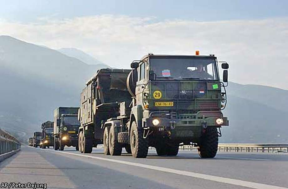 A convoy of Dutch trucks carrying patriot missile units leaves from the port city of Iskenderun, Turkey, Thursday, Feb. 27, 2003. Dutch patriot missile batteries arrived Wednesday and will be stationed in south-eastern Turkey in case of an Iraqi SCUD missile attack. Turkeys Cabinet agreed earlier this week to the deployment of tens of thousands of U.S. combat troops ahead of a possible war in Iraq but the measure is facing a final vote in Turkeys parliament. (AP Photo/Peter Dejong) Photo: PETER DEJONG