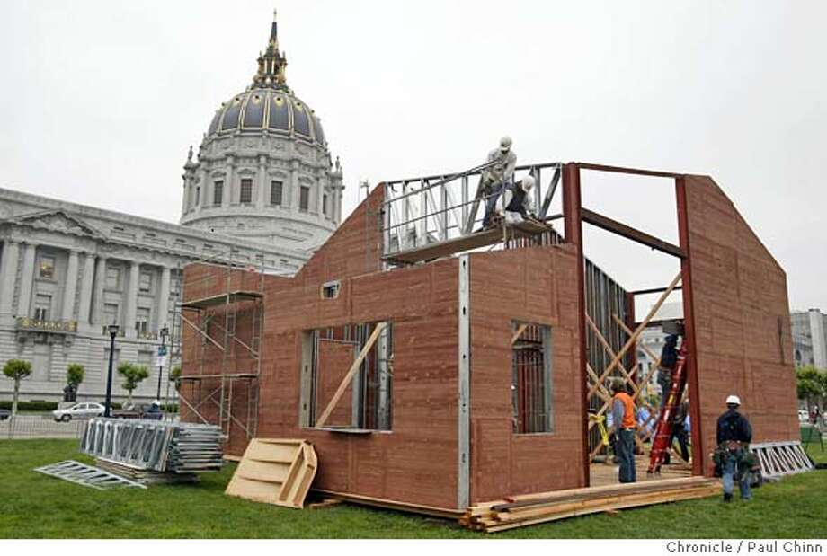 Volunteers are building a house out of scrap materials at Civic Center Plaza across from City Hall in conjunction with World Environment Day festivities on 5/27/05 in San Francisco, Calif.  PAUL CHINN/The Chronicle Photo: PAUL CHINN