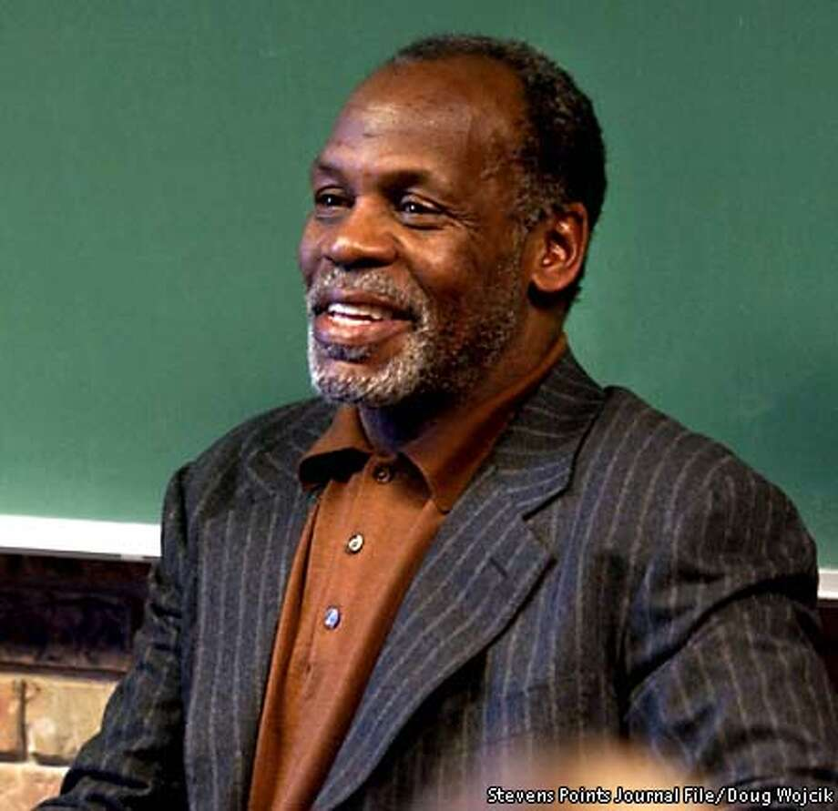 **FILE** Actor Danny Glover speaks to students Tuesday, Feb. 4, 2003, at the University of Wisconsin-Stevens Point, in Stevens Point, Wis. Glover was in town to read the poetry of Langston Hughes as part of the Performing Arts Series Lecture Attraction. (AP Photo/Stevens Points Journal, Doug Wojcik, File) Photo: DOUG WOJCIK