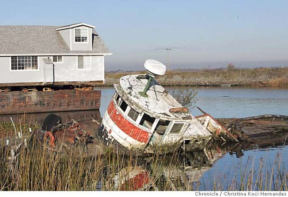 vessel06020_ckh.jpg  Abandoned boat in the Delta, off Bradford Island.The story is about Contra Costa County officials cracking down on abandoned vessels, junk and other derelict stuff in the delta. If photographer sees other examples than this, that's fine. Things get dumped in different areas of the delta, the example above was one given to me by a source who said it's extreme example. .CHRISTINA KOCI HERNANDEZ/CHRONICLE Photo: CHRISTINA KOCI HERNANDEZ