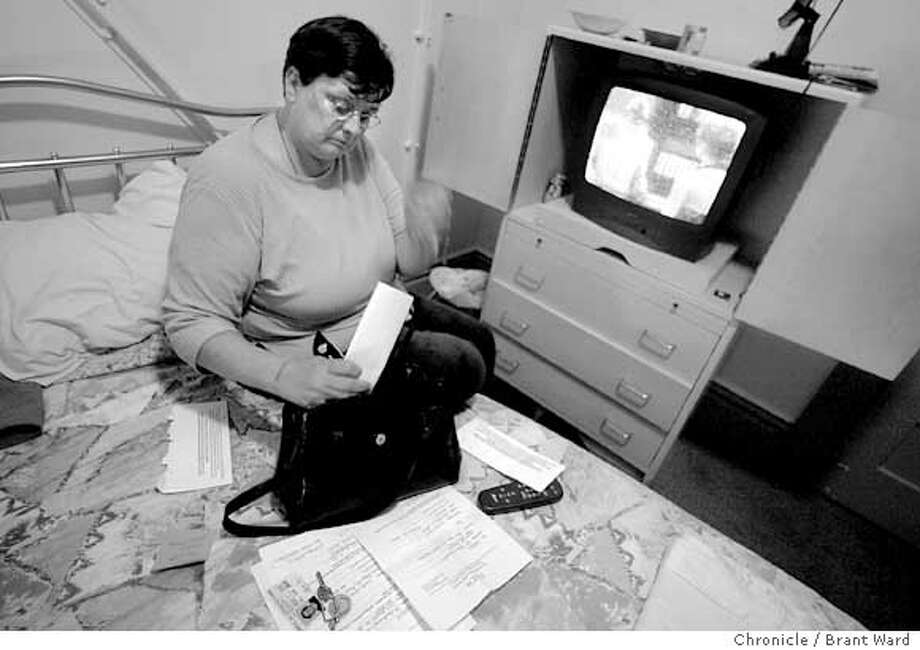 Linda Carr looks over some mail she has received at her new address at the Elm Hotel on Eddy Street. Linda was in a shelter before being placed in the supportive hotel. She is typical of the homeless persons taken from shelters who have little trouble adapting to the hotel atmosphere Brant Ward 7/19/04 Photo: Brant Ward
