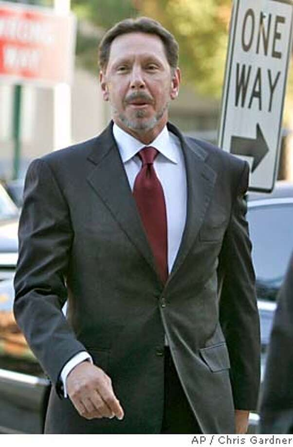Oracle CEO Larry Ellison arrives at Chancery Court in Wilmington, Del., Friday, Oct. 8, 2004. Ellison is to testify in the Oracle v PeopleSoft trial in the Chancery Court. Oracle is trying to convince a Delaware Chancery Court to remove two antitakeover defenses that PeopleSoft has employed to stop Oracle's $7.7 billion hostile bid for Peoplesoft. (AP Photo/Chris Gardner) Ran on: 10-09-2004  Larry Ellison , Oracle's CEO, arrives at Chancery Court in Wilmington, Del. Ran on: 10-09-2004  Afghan police guard ballot boxes Ran on: 10-09-2004  Afghan police guard ballot boxes Nation#MainNews#Chronicle#10/9/2004#ALL#5star##0422400953 Business#Business#Chronicle#12/6/2004#ALL#5star##0422400953 Photo: CHRIS GARDNER