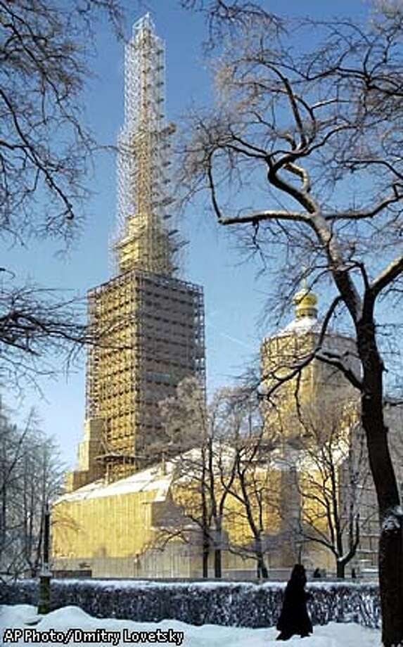 ** FOR IMMEDIATE RELEASE **St. Peter and St. Paul's Cathedral is shown under reconstruction in St. Petersburg, Russia, Dec. 25, 2002. Russia's former imperial capital, St. Petersburg, is preparing for a 300th birthday bash in May that is expected to attract more than 40 heads of state and thousands of tourists. (AP Photo/ Dmitry Lovetsky) Photo: DMITRY LOVETSKY