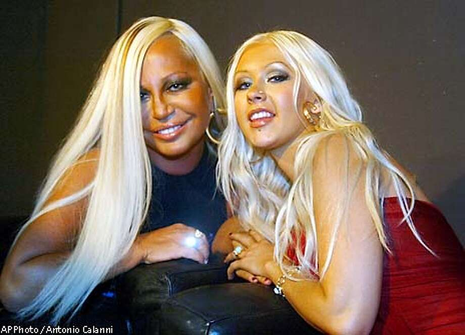 Italian designer Donatella Versace, at left, and pop star Christina Aguilera are seen at Versace's Fall-Winter fashion collection, designed by Donatella Versace, and unveiled in Milan, Italy, Tuesday, March 4, 2003. (AP Photo / Antonio Calanni) Photo: ANTONIO CALANNI