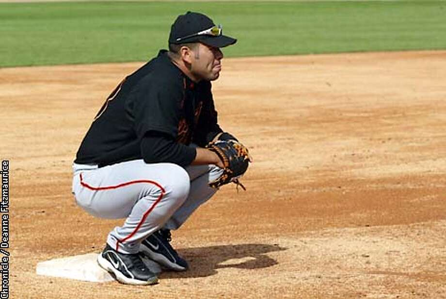 Edgardo Alfonzo is the new third baseman. He rests on his base during drills at the San Francisco Giants spring training in Scottsdale, Arizona.  CHRONICLE PHOTO BY DEANNE FITZMAURICE Photo: Deanne Fitzmaurice