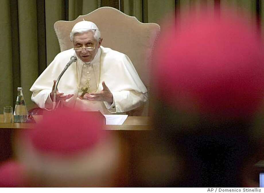 Pope Benedict XVI speaks at the opening session of the Italian bishops conference at the Vatican, Monday, May 30, 2005. The pontiff endorsed efforts by Italian bishops to restrict assisted fertility treatments, contending that an Italian referendum scheduled for June 12-13 to scrap parts of a law posed threats to life and the family. (AP Photo/Domenico Stinellis) Photo: DOMENICO STINELLIS